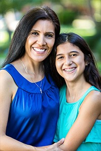Mother and Daughter with Braces Smiling